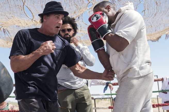 C2_17699_RActor Sylvester Stallone, director Steven Caple Jr. and actor Michael B. Jordan on the set of CREED II, a Metro Goldwyn Mayer Pictures film. Credit: Barry Wetcher / Metro Goldwyn Mayer Pictures© 2018 Metro-Goldwyn-Mayer Pictures Inc. All Rights Reserved.