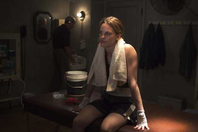 "HILARY SWANK as Maggie in Warner Bros. Pictures' drama ""Million Dollar Baby."" The Malpaso production also stars Clint Eastwood and Morgan Freeman. PHOTOGRAPHS TO BE USED SOLELY FOR ADVERTISING, PROMOTION, PUBLICITY OR REVIEWS OF THIS SPECIFIC MOTION PICTURE AND TO REMAIN THE PROPERTY OF THE STUDIO. NOT FOR SALE OR REDISTRIBUTION."